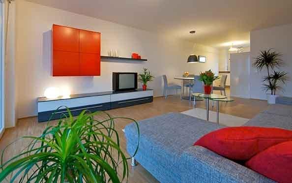 Eine Musterwohnung des Siedlungswerks, Wohnraum mit Essplatz und Küche